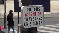Stock Video Footage of Traffic sign in Paris saying attention passengers crossing the street