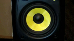 Yellow Speaker Bounces, Moves, and Shakes as Music Plays Loud - stock footage