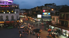 Traffic at night Ba Dinh square Hanoi North Vietnam slow motion Stock Footage