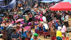 Flower Hmong hill tribe people market nr Bac Ha North Vietnam SM Stock Footage