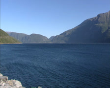 SUNNDALSFJORDEN, NORWAY: Blowing wind across water  + pan fjord Stock Footage