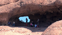 Tourists on the trail to the Hole in the Rock at Papago Park Stock Footage