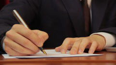 Businessman signs papers, contract, agreement, works on laptop - stock footage