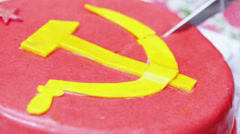CakeDivision with a hammer and sickle Stock Footage