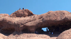 Tourist Inside Hole in the Rock at Papago Park. Stock Footage