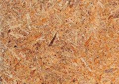 Recycled compressed wood chipboard. Stock Photos