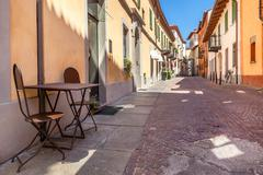 Cafe table on the street in alba, italy. Stock Photos