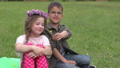 Boy suddenly gives a flower to girl in a park Stock Footage