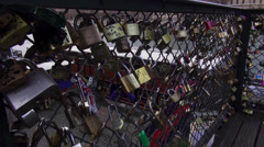 Stock Video Footage of Padlocks from lovers attached to bridge Pont des Arts in Paris