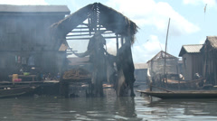 Smoke on the water, timber homes, canoes, Makoko floating slum Stock Footage