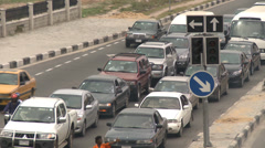 Heavy traffic stop start queuing, Nigeria - stock footage