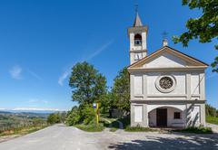 chapel on the roadside in piedmont, italy. - stock photo