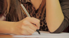 Close-up writing down information, signing papers, agreement, click for HD Stock Footage