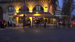 Small street cafe in Paris evening shot Stock Footage