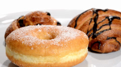 Croissant, doughnut and brioche with raisins rotating. Stock Footage