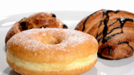 Stock Video Footage of Croissant, doughnut and brioche with raisins rotating.