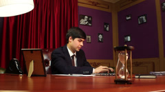 Young businessman working in office, time running, career, life, click for HD - stock footage