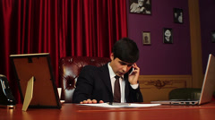 CEO businessman making a phone call, negotiations, career, click for HD Stock Footage