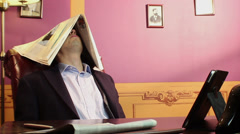 Lazy worker sleeping at workplace, tired, dreaming of vacation, click for HD - stock footage