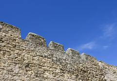 Merlons of an old fortress wall - stock photo