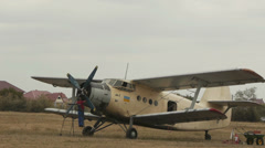 Mechanic checking engine of an old Soviet aircraft Antonov An-2R, also known as  Stock Footage
