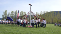 School children May Day Pole weaving fun HD 0302 Stock Footage