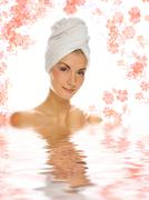 Beautiful girl with white towel on her head reflected in rendered water Stock Photos
