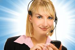 Stock Photo of beautiful hotline operator with cellphone in her hands on abstract background