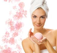 Beautiful girl with aroma bath ball Stock Photos