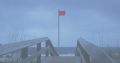 Red flag at Gulf Shores beach, dusk Stock Footage