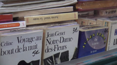Old books at a sales booth at Seine riverside - stock footage