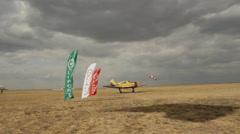 Yellow aircraft Yakovlev Yak-18T leaves the runway Stock Footage