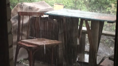 Rain Pouring on Chair and Table - stock footage
