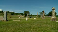 Kansas country cemetery Flint Hills pan 1 Stock Footage