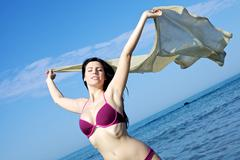 incredibly beautiful woman enjoying the sea and the wind in vacation - stock photo