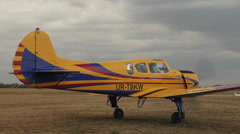 Closeup of yellow plane Yakovlev Yak-18T awaits clearance to take off with the - stock footage