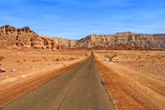 Road through red mountains in israel. Stock Photos