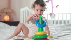 Baby builds toy pyramid - stock footage