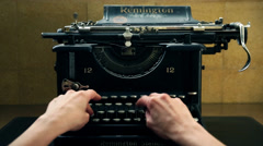 close up writting in manual typewritter desk - stock footage
