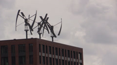 Wind turbines on the roof of a building - stock footage