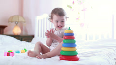 Little girl playing with toys in the children's room - stock footage