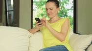 Stock Video Footage of Beautiful casual woman texting on her cell phone at home, slow motion HD