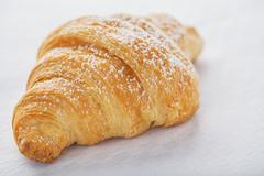 Croissant on white Stock Photos