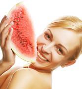 Woman ready to take a bite out of watermelon - stock photo