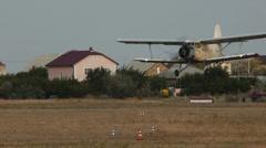 Close-up of Antonov An-2R landing Stock Footage