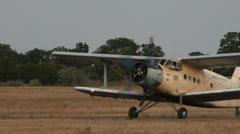 Antonov An-2R aircraft lands Stock Footage