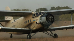Antonov An-2R turning on the airfield Stock Footage