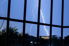 Lightnings in stormy sky Stock Photos