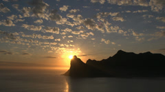 Sunset over the Sentinel Peak,Hout Bay,Capetown Stock Footage