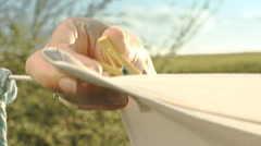 Woman Hand Putting Clothespin Close Up Stock Footage
